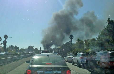 Highway 101 northbound traffic at a standstill at 5 p.m. with a sky full of smoke from a small brush fire in the 4000 block of Highway 154 (June 28, 2013)