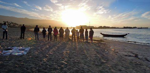 <b>PEOPLE OF THE SEA:</b>  A group of Chumash gather at dawn at West Beach to celebrate the summer solstice.