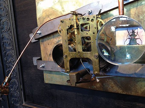 """<b>READY FOR A CLOSE-UP:</b> Norm Reed's assemblage piece """"Wheel of Flies"""" includes a magnifying glass."""