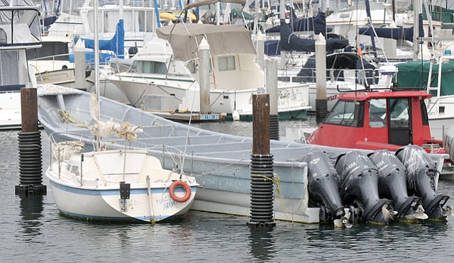 "<b>BEACH TREASURE:</b>  This ""super panga"" ​— ​like the one successfully salvaged by a Santa Barbara fisherman in April 2012 ​— ​was the centerpiece of a July 2012 press conference to highlight increased enforcement action against Mexican smugglers."