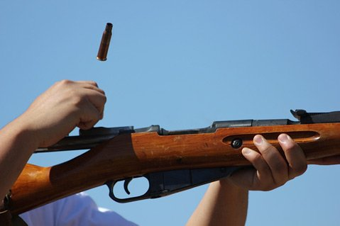<b>LOCK AND LOAD:</b>  A spent shell casing flies from the breech of a Mosin-Nagant bolt-action rifle.