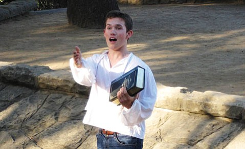 <b>PLAYS IN THE PARK:</b> Jordan Lemmond introduces <i>The Complete Works of William Shakespeare (Abridged)</i>.