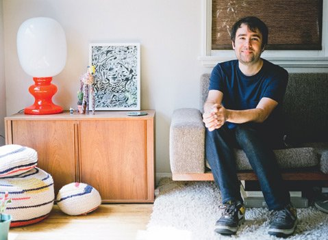 <b>HOUSE TOUR: </b> Tamborello sits in his mid-century-inspired Silver Lake home, surrounded by a selection of homemade crochet projects and collected artwork.