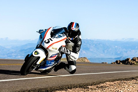 "<b>NEED FOR SPEED:</b> No stranger to taking a turn at blistering speeds, Carlin Dunne had to expertly handle a wet patch of road on the treacherously winding Pikes Peak's course. ""I was going 150 mph, and the bike was sliding,"" Dunne said of the area that brought down several contestants ahead of him. He eased up, making it through without a hitch."