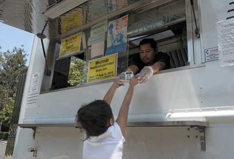<b>WELL FED:</b> Lunch is served (via food truck) at Bohnett Park.