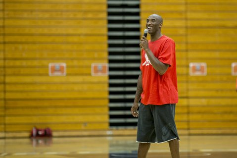 <b>BASKETBALL DIARIES:</b>  Lakers star Kobe Bryant (pictured) answers questions at a press conference during the Kobe Bryant Summer Basketball Camp at UCSB. Above: Bryant addresses camp participants at the Events Center.