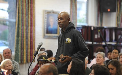 <b>SPEAKING UP:</b>  Charles Reed addresses a panel of elected officials and law enforcement representatives about race relations in Santa Barbara.