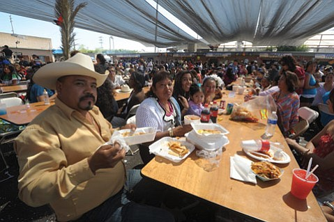 <b>MADE WITH LOVE:</b>  Our Lady of Guadalupe Mercado has long been a favorite food destination for Fiesta revelers.