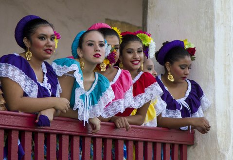 Dancers look out over the audience before the start of Fiesta Pequeña July 31, 2013, at the Old Mission in Santa Barbara, Calif.
