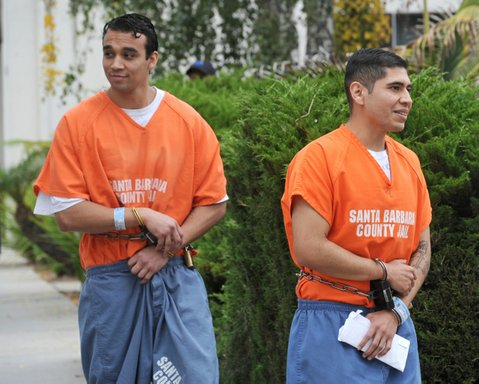 Steven Santana (left) and Miguel Parra leave the courtroom after being sentenced to 16 years in prison for the beating death of George Ied