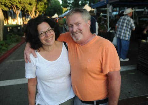 <b>SAD STATE?</b>  We may only rank 38th on the happy meter, but New York couple Chris and Carol, in town for their godson's wedding, seemed in good spirits at the downtown Farmers Market.
