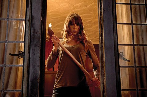 <b>FAIR GAME:</b>  A group of animal-masked killers encounters an unexpected obstacle (Sharni Vinson) in <i>You're Next</i>.