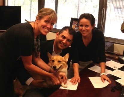 Gov. Jerry Brown's dog Sutter puts his paw of approval on AB 789. From left: Jennifer Fearing, California Senior State Director for the Humane Society of the United States; Assemblymember Das Williams; and Leslie Villegas, legislative aide to Williams.
