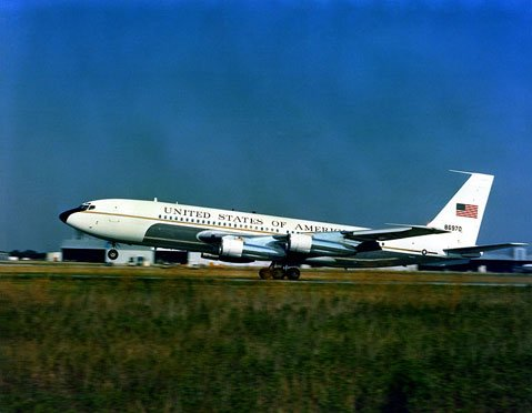 A left side view of a VC-137B Stratoliner aircraft taking off.