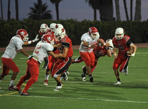 <b>SWIFT MOVES:</b>  Running back Aidan Williams (10) turned upfield behind blocks by Thomas Lash (35) and John Samson (55).