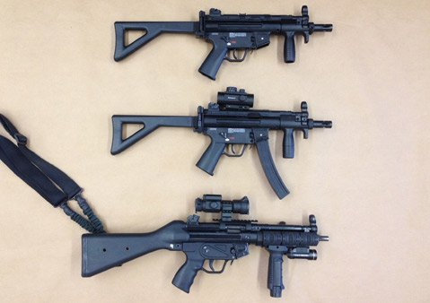 Perez's replica guns (top and center) compared to a real MP5