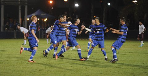 <b>TAKING IT TO THE LIMIT:</b> The Gauchos showed their potential in an exhibition game against Westmont in August. UCSB teammates cheered freshman Paul Ehmann (#4, pictured center), whose 20-yard blast whizzed past Westmont's goalie.