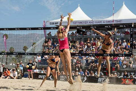 <b>SWITCHING SIDES:</b>  In 2012, Olympic Gold medalist Kerri Walsh Jennings (center) blocked a spike from opponent April Ross (right) at the AVP Women's Finals at West Beach. This year, Walsh Jennings and Ross will play the same side of the net in their first match since becoming a team.