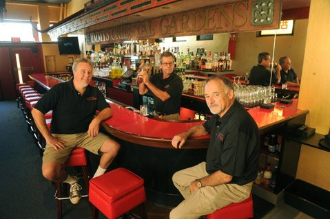 "<b>BACK HOME AGAIN:</b>  Longtime Jimmy's regular Bob Lovejoy (right) and his son Clay (left) spared no expense in remaking the historic bar into the Pickle Room. ""This building deserves it,"" said Bob, but he also believes in the people making it happen, namely bartender Willy Gilbert (middle). ""Willy is the key to this whole place,"" said Bob."