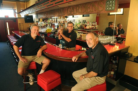 """<b>BACK HOME AGAIN:</b>  Longtime Jimmy's regular Bob Lovejoy (right) and his son Clay (left) spared no expense in remaking the historic bar into the Pickle Room. """"This building deserves it,"""" said Bob, but he also believes in the people making it happen, namely bartender Willy Gilbert (middle). """"Willy is the key to this whole place,"""" said Bob."""