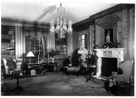 <b>BELLOSGUARDO THEN:</b> This family photo, taken in the 1940s, shows the interior of the library, including a portrait of Huguette's sister Andrée over the fireplace. The furniture has been covered, but otherwise the rooms in the mansion remain as they were 60 years ago.