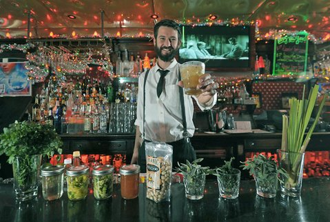 <b>MAN OF THE (HAPPY) HOUR:</b>  Wildcat barkeeper and Farm-to-Bar creator Patrick Reynolds keeps his cocktails fresh, seasonal, and oh so drinkable.