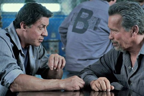 Sylvester Stallone (left) and Arnold Schwarzenegger star opposite rapper 50 Cent in <em>Escape Plan</em>.