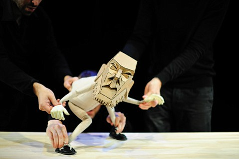 <b>HELPING HANDS:</b>  Blind Summit's The Table is a Bunraku-style puppet show starring a cantankerous cardboard-headed character named Moses in a story inspired by Beckett, the Bible and IKEA.