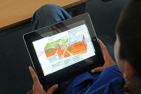 <b>Digital Lesson:</b>  Cleveland School 6th grader Kevin Sullivan learns about earth science on an iPad.