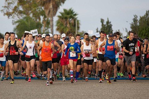 Elisa Karhu (center, in blue) begins the race