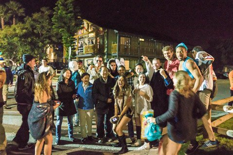 UCSB's Chancellor Henry Yang (center) kept a presence among the Halloween revelers in Isla Vista this year.