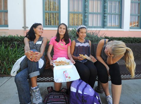 <b>PIZZA TIME:</b>  S.B. Junior High student Raphaela Griffith (second from left) shares a pie with her mom, Cece (far left), and fellow 7th graders Aisha Avellandea (second from right) and Isabel Baiz (far right) at the school's parent-student lunch.