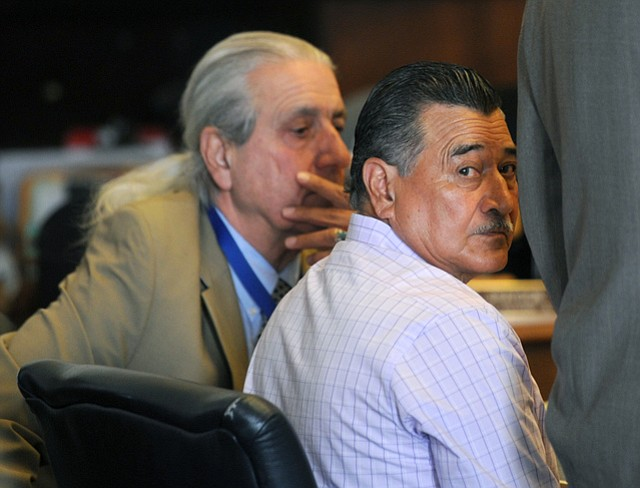 Carlos Ruano sits with an interpreter at his sentencing hearing