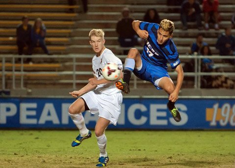 <b>FLYING HIGH:</b> UCSB sophomore Marshall Cazares (pictured right, mid-jump) took a shot off the side of his foot to tie the score 1-1 with Cal State Northridge. The Gauchos ultimately lost the game against the Matadors, 3-2.