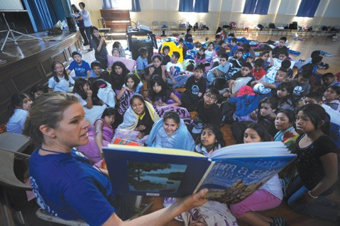 <b>READ TO ME:</b>  Students at McKinley gather around their teacher for story time. Many of the kids' parents grew up in Mexico and have limited formal education themselves, so the school adopted a program called Padres Adelantes, which explains the American educational system to parents.