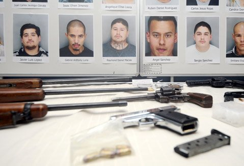 <b>NAME AMONG NAMES: </b> Police made special note of the recent arrest of Raymond Macias (mug shot pictured above center), a defendant on the city's proposed gang-injunction list and the former Eastside program coordinator for La Palabra, ​a nonprofit working with at-risk youth.