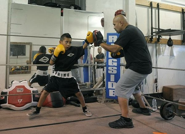 Eight year-old Julio Montezuma trains in the ring with Joe Pommier (June 27, 2011)