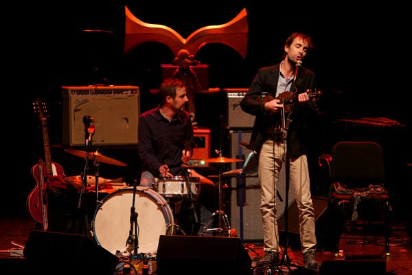 Andrew Bird (right), onstage at UCSB's Campbell Hall with The Handsome Family.