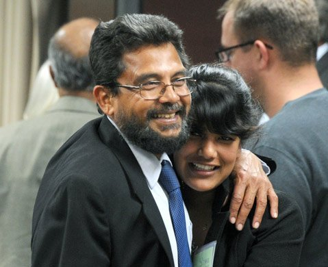 <b>ALL SMILES: </b> Islamic Society of Santa Barbara cofounder Mukhtar Khan celebrates with his daughter, Dalia Khan, after the Goleta Planning Commission voted unanimously to send the proposed mosque project to the City Council.