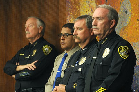 <b>FULL-COURT PRESS:</b>  Several law-enforcement officers—including (from right) Santa Maria Police Chief Ralph Martin, Hancock College Public Safety Director Wesley Maroney, California Highway Patrol Santa Maria office commander Lt. Alex Carrillo, and Guadalupe Police Chief Gary Hoving—spoke before the supes in support of a plan for the Santa Maria Branch Jail.