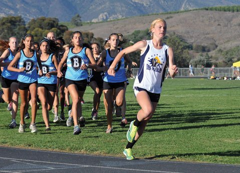 "<b>LONG-DISTANCE LEADER:</b> ""I like cross-country more because I like the longer distances and the scenery,"" said Dos Pueblos runner Addi Zerrenner. Zerrenner, pictured at the front of the pack, has won every race in her cross-country career on the DP course."