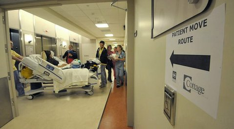 A patient is moved from Cottage Hospital's existing wings to the new patient pavilions. (February 2012)