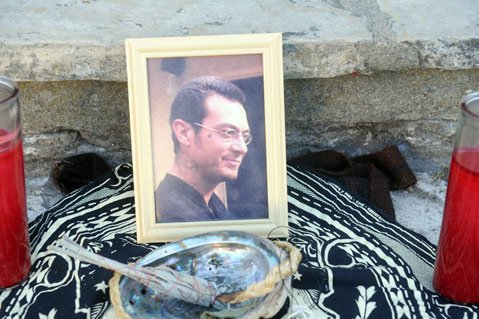 Mourners placed a picture of Brian Tacadena in his younger years at the site where he was killed.