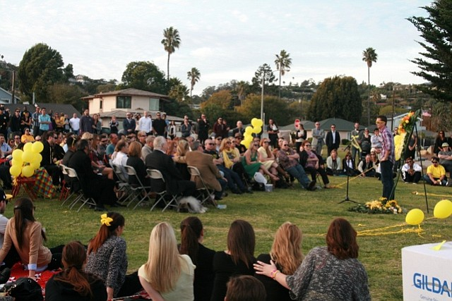 A friend speaks during Mallory Dies's memorial service at Shoreline Park