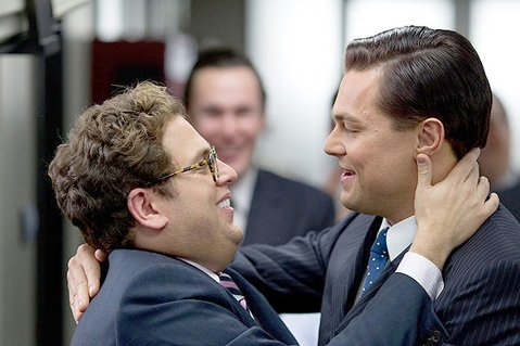 <b>WOLF IN SLEEK CLOTHING:</b>  Leonardo DiCaprio (right) depicts the devilish exploits of stockbroker/scam artist Jordan Belfort in Martin Scorsese's <i>The Wolf of Wall Street</i>.