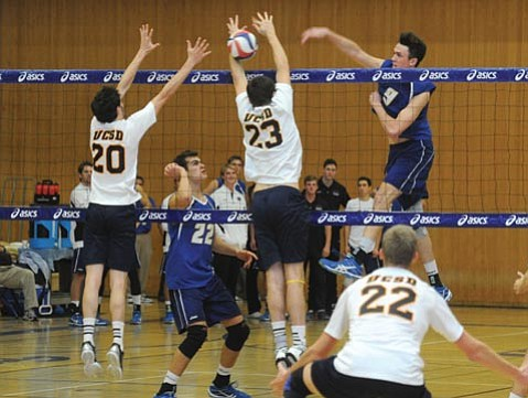 <b>HIT MAN:</b> UCSB's Ryan Thompson (#9) powers the ball through the UC San Diego block after a set by Jonah Seif (second from left).