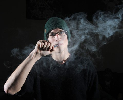"""<b>HAZED AND DIFFUSED:</b> Collin Walker puffs away on his """"mod"""""""
