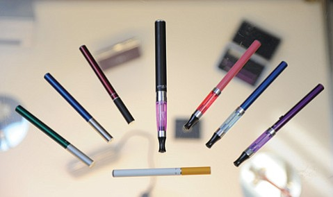 <b>RANGE OF OPTIONS:</b> Some e-cigarettes — both disposable and rechargeable — are shaped like their traditional counterparts. Others are larger and more intricate.