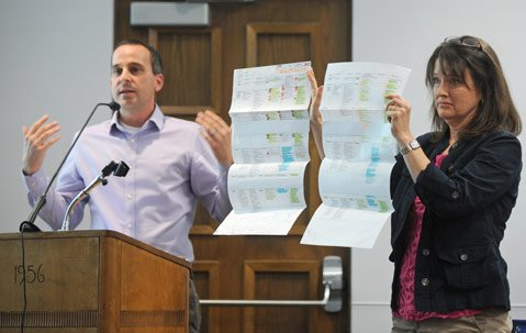<b>CALCULATED DECISION:</b> Educators Craig Schneider and Janet Hollister explain the difference between an integrated and traditional math sequence to school boardmembers.