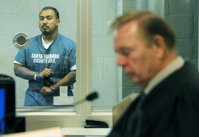 Raymond Morua at his third delayed arraignment. Judge Thomas Adams in the foreground.